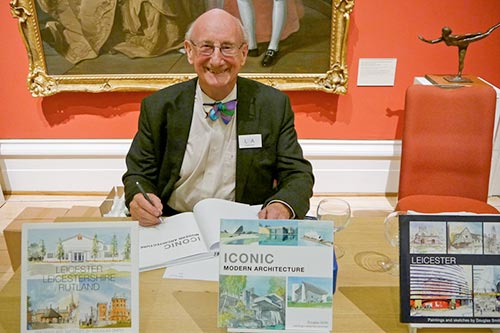 A photograph of Douglas signing his new book